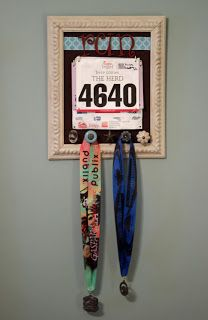 DIY project :)- Love the bib holder and medal hooks within a frame. Some inspiration to keep me running!