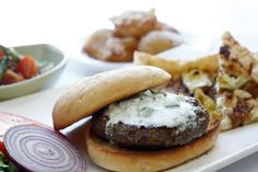 Lamb Burgers with Greek Yogurt Sauce at Light Bistro, 2801 Bridge Ave., Ohio City neighborhood of Cleveland, 216-771-7130. This Ohio City mainstay offers a great variety of dishes - including many that might appear rather simple or straightforward but usually manage to pull off some surprising or interesting combination of flavors and styles. You can find impressive and expensive fare here alongside great pizza and burgers or imaginative vegetarian options. -- Bob Migra