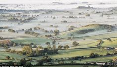Picturesque: Fog blankets the Mendip Hills in Somerset, but in the foreground, a few settl...