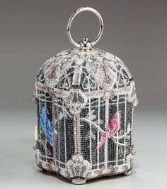 Judith Leiber Clutches. I don't like many of her things but this birdcage is phenomenal.