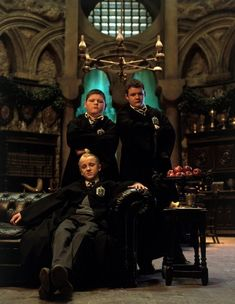 Hanging in the Slytherin common room with Draco Malfoy, Vincent Crabbe and Gregory Goyle.