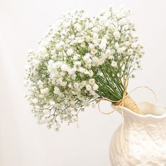 Baby's breath wedding bouquet | This is amazing! Head over to La Bloom Florist where you can see more of their unique works http://www.bridestory.com/la-bloom-florist/instagram