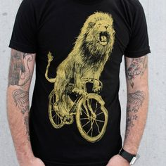 Dark Cycle Clothing: Lion On Bicycle T-Shirt, at 26% off!
