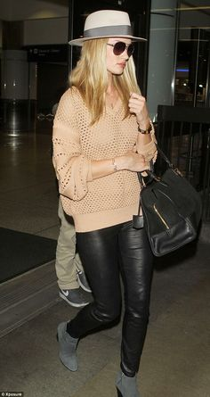 Peach perfect: Wearing a cute heavy knit, the model-turned-designer-turned-actress looked rosy as she headed for her car