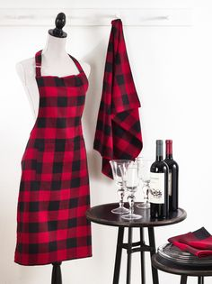 Plaid apron and kitchen towels in red