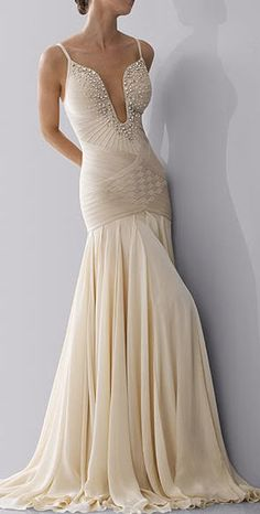 Herve Leger This light, flowing drop waist floor length wedding dress would be perfect for an outdoor garden or beach wedding in the summer.   Pinned on jevelweddingplanning.com pinterest board for wedding dresses. Love the bottom of the dress, not so much the top.
