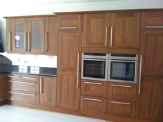 Walnut tall units with integrated appliances
