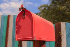 red postbox on old wooden background