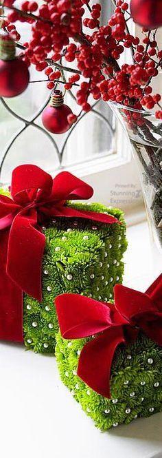 DIY Christmas package decorations inspiration: Styrofoam blocks, Silk flowers, pearl-head pins. Velvet ribbon. Boom.