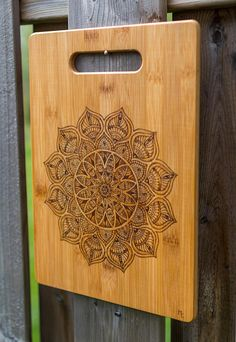 Gift for her! This is a beautiful Mandala freehand pyrography art, custom design that is burned onto a 9-1/2 x 13 (24.1 x 33 cm) high-quality real bamboo cutting board and mineral oiled to be food safe! Board thickness is 3/8 (1 cm).  This custom art-crafted board makes a perfect Thanksgiving, Housewarming, Holidays, Christmas, Wedding, Anniversary or Birthday present! This unique, one-of-a-kind gift has a warm and personal feel that will touch the special person in your life! This ...