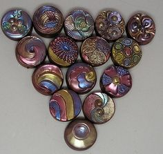 Betty Joe Hendershot - Polymer clay button beads with pearlex powders.    http://www.flickr.com/photos/auntgriz/3728294354/
