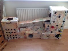 I created this as a playhouse for my cat , it's made out of old cardboard boxes and glued together with pva glue then decorated to suit your own taste and he loves it!