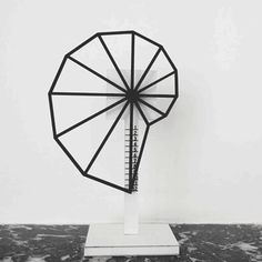 This #prototype #clock tells time in a straight line with a pivoting shell-like structure.