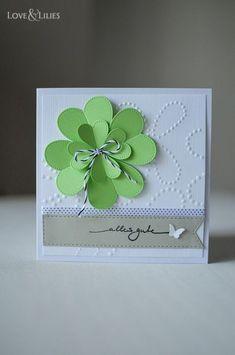 dfd76ddd0f989 Eine selbstgemachte Geburtstagskarte mit vierblättrigem Kleeblatt.