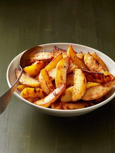 Crispy Garlic-Sage Potatoes from FoodNetwork.com ~ Roasted potato wedges soar to new heights when cooked with bold flavors like sage and garlic. Spiking the oven temperature toward the end ensures crispy perfection.