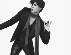 Adam Pålsson for Café Magazine. Wearing a 70s style tight scarf, black jacket and leather pant. Black & white photography