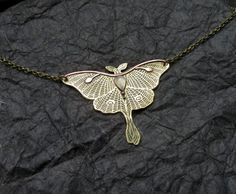 Luna Moth Necklace is made of brass and copper in sawing, etching and soldering techniques. Its entirely handmade. All patterns are designed and