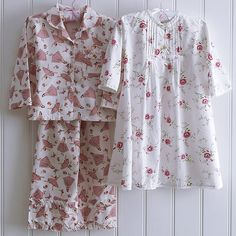 The Rosy nightdress is the sweetest little nightdress, all cotton, printed with rosebuds and embellished with hand embroidery. Cotton lace trim around the neck, cuffs and hem. Mother Of Pearl Buttons, Mother Pearl, Cotton Lace, Rose Buds, Pyjamas, Cologne, Nightwear, Hand Embroidery, Lace Trim