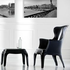 Designers Claudio Dondoli and Marco Pocci put a modern spin on the classic wingchair for this versatile seat. The Pasha Chair blends tradition with new school style: its 100% polycarbonate construction in glossy black works in any environment, from restaurants and hotels to home offices and verandas. $390.00