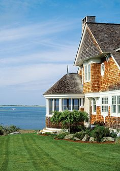 New England beach house - love the circular screened in porch!!