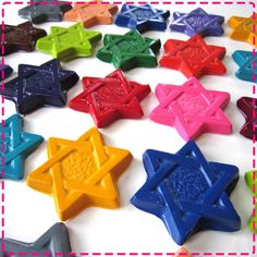 I think this would be easy enough to melt regular crayons in a cute form...   Star of David Chanukah crayons, $20