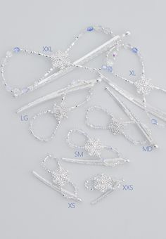 Shimmering snowflake gently settles amidst the lucid crystals of ice blue, aurora borealis, and clear. A delicate arrangement of silver plated beadwork and faceted glass. Perfect for the updo, the warm winter scarf, and even as napkin rings at a lovely holiday dinner setting.