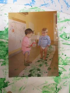 Documentation: pictures of toddlers painting on the actual painting that is displayed. Also, add a description of the learning process.