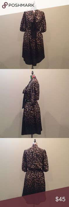 Vince Camuto Ombré Leopard Blouson Dress Fierce leopard print dress with adorable neck tie design. Small black belt at waist is attached. Worn two times, in amazing condition! Pockets at waist. This dress is perfect for the creative office! Vince Camuto Dresses Midi