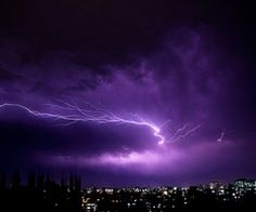 Capture lightning in a photograph.