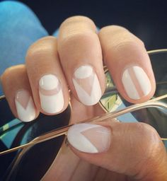 Go for the minimalist approach and create these beautiful shapes using white nail polish and your natural nail color.