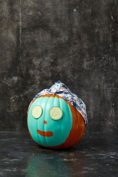 17 Easy Pumpkin Faces to Make Your Jack-o-Lantern Stand Out This Halloween painted-face-mask-spa-pumpkin pumpkins spa Easy Pumpkin Faces, Pumpkin Uses, Pumpkin Art, Cute Pumpkin, Fun Pumpkin Ideas, Pumpkin Face Carving, Pumpkin Face Paint, Pumpkin Painting, Pumpkin Carvings