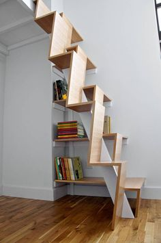 Space-saving alternating tread stairs with integrated book shelves. My kids probably couldn't manage such big steps.