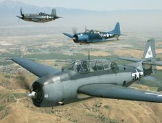 TBF Avenger torpedo bomber, in front of an SBD Dauntless dive bomber and an F4U Corsair fighter at Chino 2011
