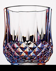 By Steve Gallagher. I think that this classes as bold shapes. I really like this glass still life photo because of all the colours that reflect off of the shape of the glass.