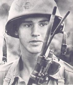Bull's Eye - U.S. Marine PFC. Jerry D. Goff of St. Louis MO. examines a split barrel of his M-14 rifle which was hit square in the bore by Viet Cong sniper bullet during exchange of fire with guerrillas at My Song, south of DaNang. Goff was slightly wounded in the face by the freak occurrence. AP Wire Photo April 25, 1965