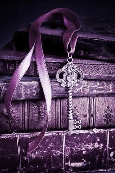 Purple Vintage Books with a Key Bookmarker
