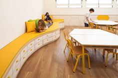 King Solomon School designed by Sarit Shani Hay | storage and couch