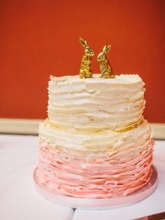 Pink ombré cake with gold bunny toppers