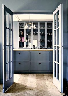 grey kitchen with herringbone wood floor