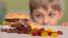 Crack-down on advertising to children is coming, but junk food packaging isn't included.
