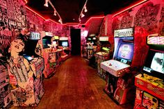 Cool integrated wall designs onto arcade cabinets.