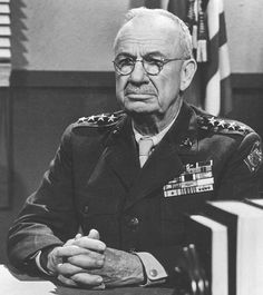 Portrait of Lieutenant General Holland Smith, aka General Howling Mad Smith.  In Aug 1944 he was appointed Commanding General of the Fleet Marine Force of the Pacific while he retained the leadership role of the V Amphibious Corps. He played a critical role in the Battle of Iwo Jima as well. He returned to the United States in Jul 1945 to head up the Marine Training and Replacement Command at Camp Pendleton, California.