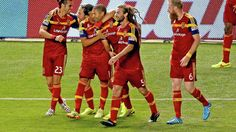 Teammates hug Real Salt Lake forward Alvaro Saborio (center) after he scored as the Real Salt Lake defeats FC Dallas 2-1 in MLS soccer, Saturday, Sept. 6, 2014