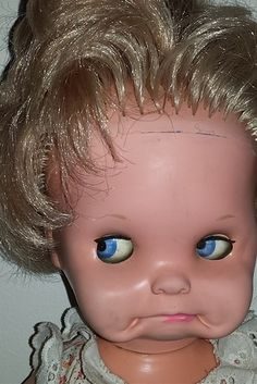 11 (Unintentionally) Scary Vintage Dolls That Will Make Your Skin Crawl.      Saucy, the doll that allows you to mold its face into horrifying poses.