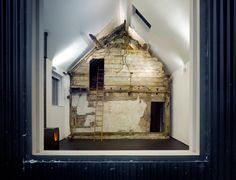 Architects preserve rotting structure in conversion of 18th-century cottage