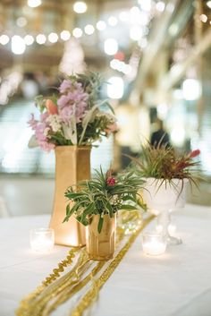 air plant centerpieces, photo by Suzuran Photography http://ruffledblog.com/new-years-eve-cleveland-wedding #airplants #wedding #gold
