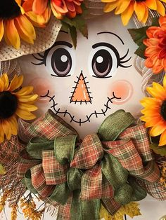 What an cute girly scarecrow with a hat stuffed with fall flowers so as to add to your fall decor. A enjoyable solution to greet your family and friends this fall season or to make[. Deco Mesh Garland, Deco Mesh Wreaths, Fall Wreaths, Door Wreaths, Moldes Halloween, Adornos Halloween, Scarecrow Face, Scarecrow Wreath, Fall Halloween