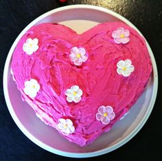 Pink heart cake with flowers  {I hope this doesn't offend the beautiful person who made it...}  I love this cake. Not perfect - but I think it's beautiful and achievable.