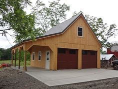 Barn style garage built with Pine board & batten siding, high roof pitch and lean-to overhang.
