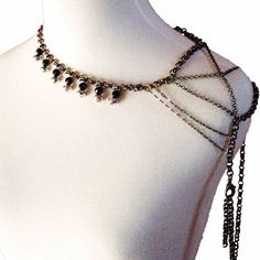 This?  So lovely I can hardly stand it.  (Black onyx shoulder piece by Sweet 1985)